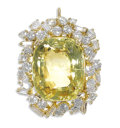 Estate Jewelry:Pendants and Lockets, Yellow Sapphire, Diamond, Gold Enhancer. The enhancer centers acushion-shaped yellow sapphire measuring 27.50 x 14.80 mm,...