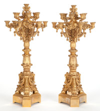 A PAIR OF LOUIS XVI-STYLE THIRTEEN-LIGHT GILT METAL CANDELABRA France, circa 1880 38 inches high (96.5 cm) <