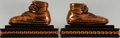 Books:Prints & Leaves, [Bookends]. Pair of Matching Baby Shoe Bookends. Bronze finish. Afew light surface rubs and a bit dusty, but with a rich pa...(Total: 2 Items)