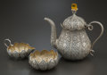 Silver & Vertu, A THREE-PIECE INDIAN SILVER TEA SET. Maker unknown, 20th century. Marks: Unmarked . 7-5/8 inches high (19.4 cm) (tea pot). 2... (Total: 3 )