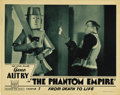 "Movie Posters:Science Fiction, The Phantom Empire (Mascot, 1935). Lobby Card (11"" X 14""). Here's arare card from this great serial. It's the tinman with t..."