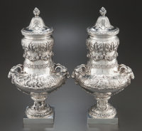 A PAIR OF HANAU SILVER COVERED URNS Maker unidentified, Hanau, Germany, circa 1890 Marks: (bunch of grapes), (l