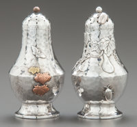 A PAIR OF TIFFANY & CO. JAPANESQUEHAND-HAMMERED SILVER AND MIXED METAL SALT AND PEPPER SHAK