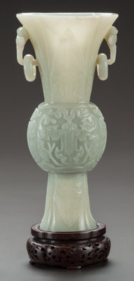 A CHINESE CARVED HARDSTONE GU VASE China, Qing Dynasty 10-1/2 inches high (26.7 cm)