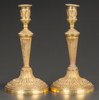 A PAIR OF FRENCH EMPIRE-STYLE GILT BRONZE CANDLESTICKS France, circa 1900 10-1/2 inches high (26.7 cm)