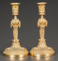 Decorative Arts, French:Lamps & Lighting, A PAIR OF FRENCH EMPIRE-STYLE GILT BRONZE CANDLESTICKS. France,circa 1900. 10-3/4 inches high (27.3 cm). ... (Total: 2 Items)