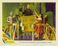 """The Wizard of Oz (MGM, R-1949). Lobby Card (11"""" X 14""""). Frank Morgan's costume as the Wizard was chosen from a..."""
