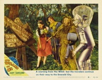 "The Wizard of Oz (MGM, R-1949). Lobby Card (11"" X 14""). In this scene card, Bert Lahr holds a Flit gun marked..."