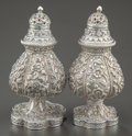 Silver Smalls:Other , A PAIR OF INDIAN SILVER SALT AND PEPPER SHAKERS. Maker unknown,circa 1900. Marks: Unmarked. 4-1/2 inches high (11.4 cm). 7....(Total: 2 )