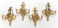 Decorative Arts, French:Lamps & Lighting, A SET OF FOUR FRENCH GILT BRONZE NEOCLASSICAL-STYLE FOUR-ARMSCONCES. France, circa 1920. 32 inches high (81.3 cm). ... (Total:4 Items)