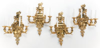 A SET OF FOUR FRENCH GILT BRONZE NEOCLASSICAL-STYLE FOUR-ARM SCONCES France, circa 1920 32 inches high (81.3 cm