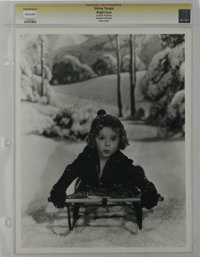 """Bright Eyes - Culver Pictures (Fox, 1934). Still (11"""" X 14""""). Shirley Temple by Otto Dyar. Highly staged studi..."""