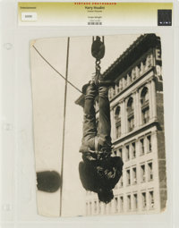 """Harry Houdini - Culver Pictures (c.1935). Still (7.25"""" X 9.5""""). Harry Houdini tied and hanging upside down in..."""