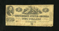 Confederate Notes:1862 Issues, T42 $2 1862. This is a well circulated Second Series note that hasnot lost any pieces. Good-Very Good....