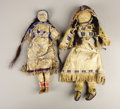 Paintings, TWO SIOUX BEADED HIDE DOLLS. c. 1890. ... (Total: 2 Items)