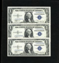 Small Size:Silver Certificates, Fr. 1608* $1 1935A Silver Certificate Stars. Three Consecutive Examples. Choice Crisp Uncirculated.. Three consecutive examp... (Total: 3 notes)
