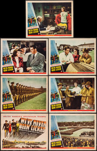 """We've Never Been Licked (Universal, 1943). Title Lobby Card and Lobby Cards (6) (11"""" X 14""""). War. ... (Total:..."""