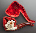 Decorative Arts, Continental, A MEERSCHAUM PIPE OF A BUFFALO WITH ORIGINAL CASE. Late 19thcentury. 9 inches long (22.9 cm). ...