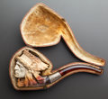 Decorative Arts, Continental, A MEERSCHAUM PIPE OF AN AMERICAN INDIAN HEAD WITH ORIGINAL CASE.Late 19th century . 8 inches long (20.3 cm). ...