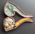 Decorative Arts, Continental, A MEERSCHAUM PIPE OF A FEMALE MOOR WITH ORIGINAL CASE. Late 19thcentury. 7 inches long (17.8 cm). ...
