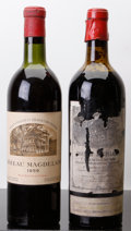Red Bordeaux, Chateau Magdelaine 1959 . St. Emilion. 1vhs, 1hs, 1htal,1-bottled in Bruxelles, excellent color. Bottle (2). ... (Total: 2Btls. )