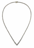Estate Jewelry:Necklaces, Diamond, Gold Necklace. The V-style necklace features a graduatedline of full-cut diamonds weighing a total of approximat...