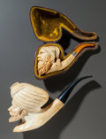 Decorative Arts, Continental, TWO BEARDED FIGURAL MEERSCHAUM PIPES . Late 19th century. 8-1/2inches long (21.6 cm) (longer). ... (Total: 2 Items)