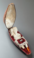 Decorative Arts, Continental, A MEERSCHAUM PIPE OF A RECLINING WOMAN WITH ORIGINAL CASE. Late19th century. 5 inches long (12.7 cm) (bust of woman). ...