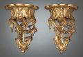Decorative Arts, French, A PAIR OF CARVED GILT WOOD WALL BRACKETS. 20th century. 12 incheshigh (30.5 cm). ... (Total: 2 Items)