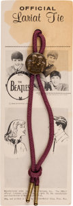 "Music Memorabilia:Memorabilia, Beatles Rare ""Official Lariat Tie"" on Original Card (Seltaeb, 1964)...."