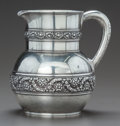 Silver & Vertu:Hollowware, A TIFFANY & CO. SILVER BANDED REPOUSSÉ WATER PITCHER. Tiffany & Co., New York, New York, circa 1877-1878. Marks: TIFFANY &...