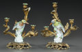 Decorative Arts, Continental, A PAIR OF GILT BRONZE CANDELABRA MOUNTED WITH PORCELAIN BIRDS. 20thcentury. 13-3/8 inches high (34.0 cm). ... (Total: 2 Items)