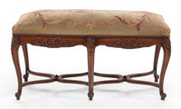 A FRENCH PROVINCIAL CARVED WALNUT BENCH WITH AUBUSSON UPHOLSTERED CUSHION 20th century 23 x 40 x 15 inches (58