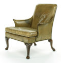 Furniture , A GEORGE II-STYLE LIBRARY ARMCHAIR UPHOLSTERED IN GREEN LEATHER. Early 20th century. 40 inches high x 32-1/2 inches deep...