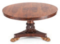 Furniture , A REGENCY-STYLE ROSEWOOD TILT-TOP ROUND TABLE ON A TRIPARTITE BASE. 19th century. 38 inches high x 52 inches diameter (9...