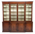Furniture , A GEORGE III-STYLE MAHOGANY BREAKFRONT BOOKCASE. Circa 1900. 102 x 103-3/4 x 19-3/4 inches (259.1 x 263.5 x 50.2 cm)...