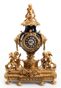 A SÈVRES-STYLE COBALT PORCELAIN AND GILT BRONZE MANTLE CLOCK Late 19th century 26-3/4 x 19 x 7 inches (67.9 x 4...