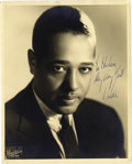 """Music Memorabilia:Autographs and Signed Items, Duke Ellington Signed Photo. A vintage b&w 8"""" x 10"""" photo ofthe Jazz band leader, inscribed and signed by him in blue ink. ...(Total: 1 Item)"""