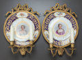 Ceramics & Porcelain, A PAIR OF SÈVRES-STYLE PLATES MOUNTED AS TWO-LIGHT SCONCES. Circa 1900. Marks: (pseudo Sèvres marks). 14-1/2 inches high (36... (Total: 2 Items)
