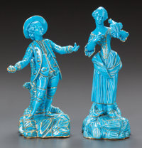 A PAIR OF BLUE PORCELAIN FIGURINES OF A LADY AND A GENTLEMAN Early 20th century Marks: spurious Sèvres marks
