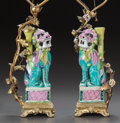 Asian:Chinese, A PAIR OF PAINTED PORCELAIN AND GILT BRONZE MOUNTED FOO DOG TABLELAMPS. 20th century. 19 inches high (48.3 cm). ... (Total: 2 Items)