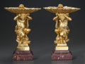 Decorative Arts, Continental, A PAIR OF CONTINENTAL GILT BRONZE PUTTI AND SHELL-FORM TAZZAS. 19thcentury. 14 inches high (35.6 cm). ... (Total: 2 Items)