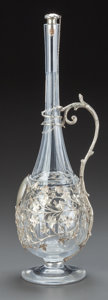 Decorative Arts, Continental, A BACCARAT GLASS AND SILVERED METAL MOUNTED CLARET JUG. 19thcentury. Marks: BACCARAT, FRANCE . 18 inches high (45.7cm)...