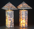 Decorative Arts, Continental, A PAIR OF ONYX TABLE LAMPS WITH PYRAMIDAL SHADES. 20th century.24-1/2 inches high (62.2 cm) (with shade). ... (Total: 2 Items)