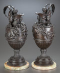 Bronze:European, A NEAR PAIR OF BRONZE WINE AND WATER EWERS ON MARBLE BASES, AFTER SIGISBERT-FRANCOIS MICHEL. 20th century. 18 inches high (4... (Total: 2 Items)