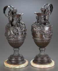 A NEAR PAIR OF BRONZE WINE AND WATER EWERS ON MARBLE BASES, AFTER SIGISBERT-FRANCOIS MICHEL 20th century 18 inc