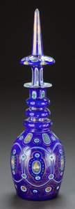 Decorative Arts, Continental, A BOHEMIAN COBALT, GILT AND JEWELED GLASS DECANTER. Circa 1900. 18inches high (45.7 cm). ...