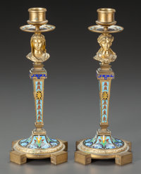 A PAIR OF CHAMPLEVÉ ENAMEL AND FIGURAL GILT BRONZE CANDLESTICKS Early 20th century 9-1/2 inches high (24.1 cm)