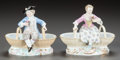 Ceramics & Porcelain, Continental:Modern  (1900 1949)  , A PAIR OF MEISSEN PORCELAIN FIGURAL DOUBLE OPEN SALTS. 20th century. Marks to boy: (crossed swords in underglaze blue), 14... (Total: 2 Items)
