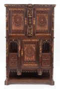 Furniture : Continental, A GOTHIC REVIVAL CARVED WOOD AND PARCEL-GILT CUPBOARD. 19thcentury. 73-5/8 x 45-3/4 x 19-1/4 inches (187.1 x 116.2 x 48.9 c...
